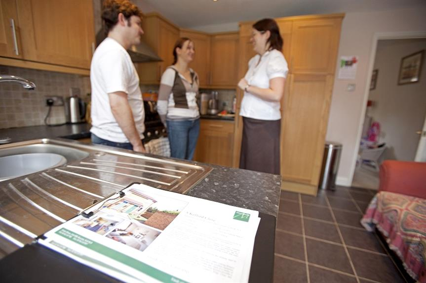 A young couple being shown around a house by an estate agent. Pic: Getty Images