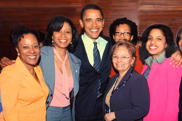 Michele Moore, to the right of former President Barack Obama