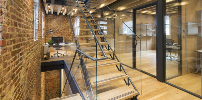 Oak and steel compliment heritage brick in carbon neutral mews house refurbishment for sustainable agriculture company's London office
