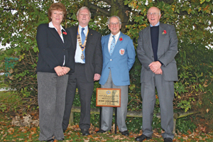 Rotary Club members unveil plaque at NEC