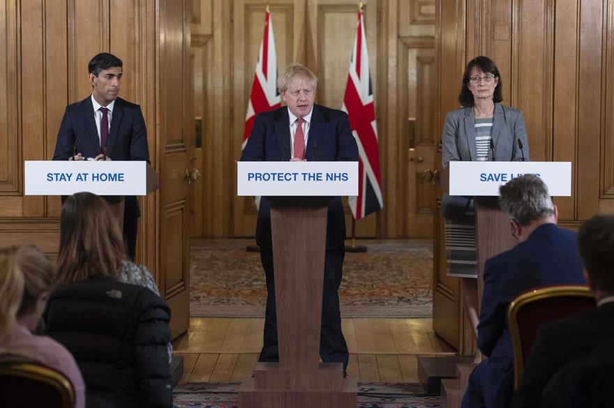 Chancellor Rishi Sunak (L), Deputy Chief Medical Officer Dr Jenny Harries (R) and British PM Boris Johnson.