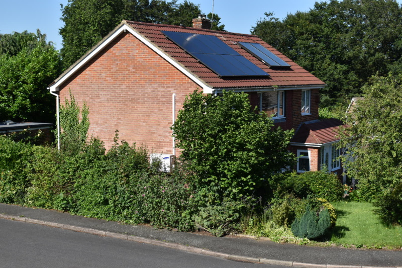 The cost of domestic retrofits - such as this house with heat pump, solar thermal and photovoltaic systems - is too great for the public to bear, say some MPs. Photograph: Gareth Simkins
