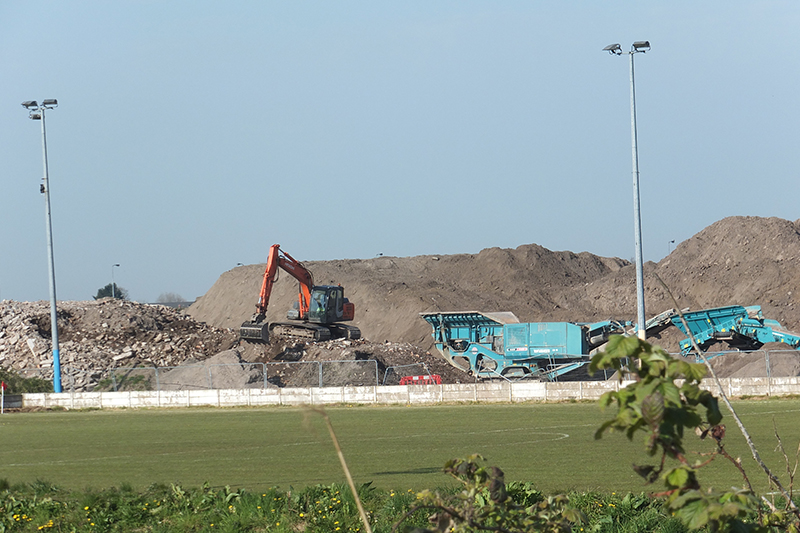 Mounds of construction and demolition waste have towered over Formby Football club for more than a year. Photograph: Derek Baxter
