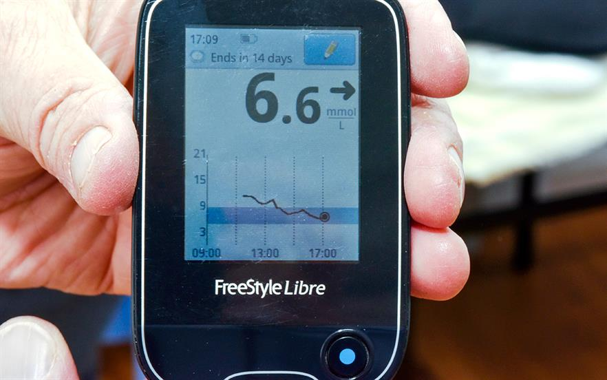 The FreeStyle Libre reader displays ambulatory glucose monitoring data detected by a sensor worn on the upper arm. | DR P MARAZZI /SCIENCE PHOTO LIBRARY