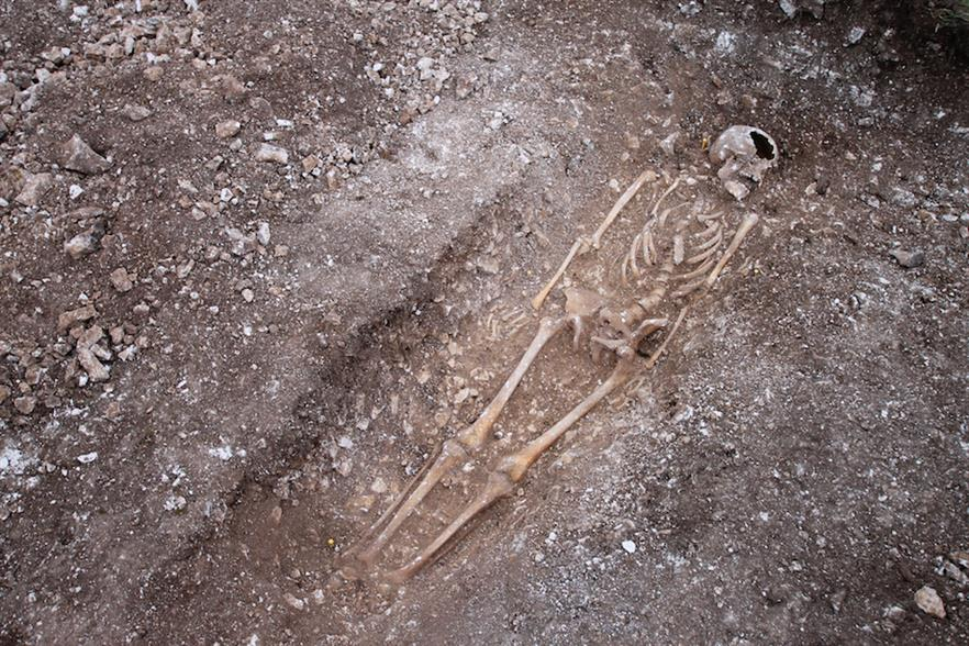 The skeleton was laid to rest facing upwards with his arms at his side, in a grave cut into chalk bedrock (pic credit: E.on)