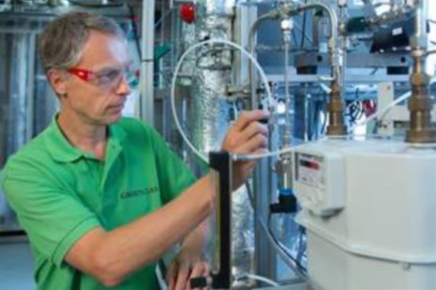 ECN's Bram van der Drift at work on the lab-scale gasification plant. Credit: Jan Buwalda