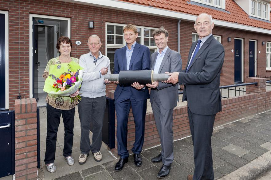 Mrs and Mr de Boer owners of the 10,000 home with local councillors and HVC staff