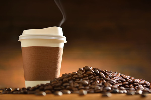Coffee cup and coffee beans Photograph: Somsak Sudthangtum/123RF