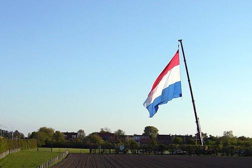 The Dutch flag flown from a crane