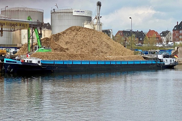 One of the barges loaded with waste wood