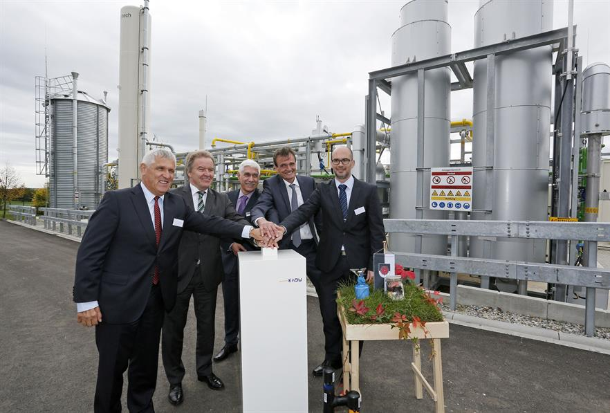 Dignitaries including  environment minister Franz Saucer (second left) start the facility