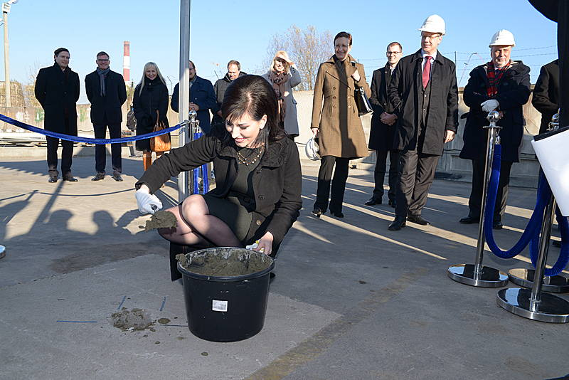 Lithuanian environment minister Daiva Matoniene starts the construction work