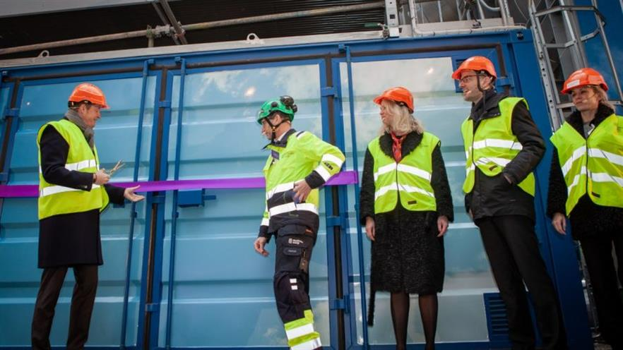 Sweden's energy minister Anders Ygeman (left) opening the plant