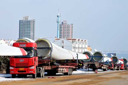 Huaneng Group installing turbines at a wind farm in Rushan, east China's Shandong Province