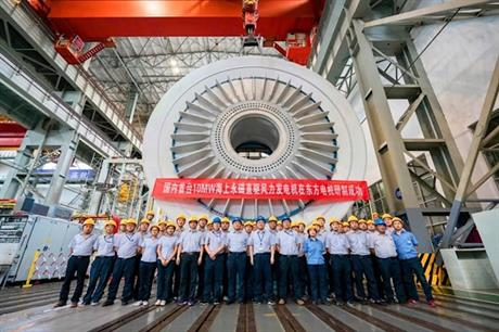 Fight them or join them: Dongfang technicians pose in front of new 10MW offshore turbine generator (pic credit: Sasac)