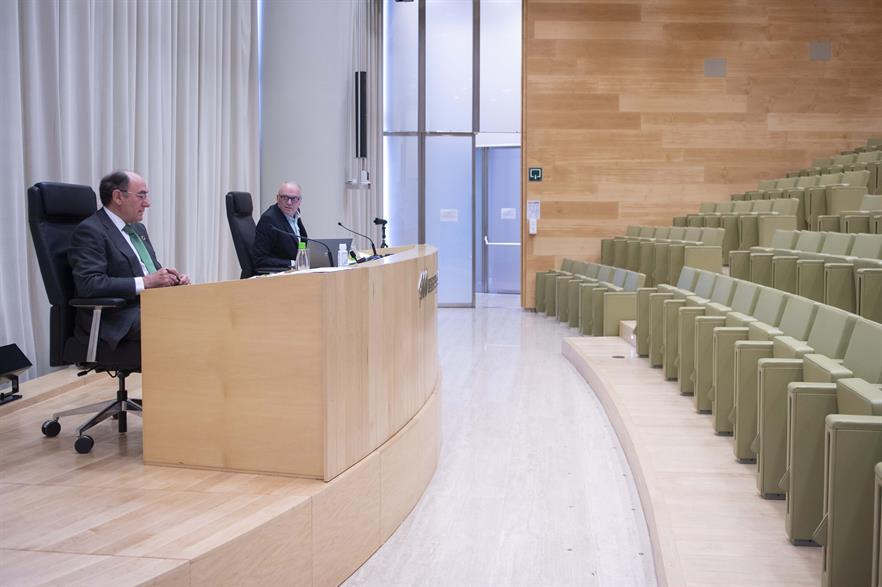 Galán and Martinez-Simancas address an empty conference room