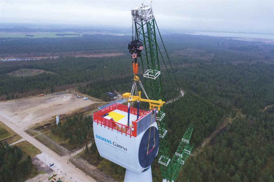 The nacelle for Siemens Gamesa's SG 11.0-200 DD turbine being lifted at an onshore test site