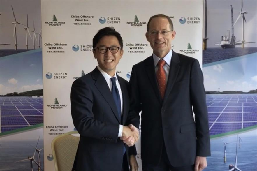 Masaya Hasegawa, representative director of Shizen Energy and David Povall, executive vice president of development at Northland, after signing the deal