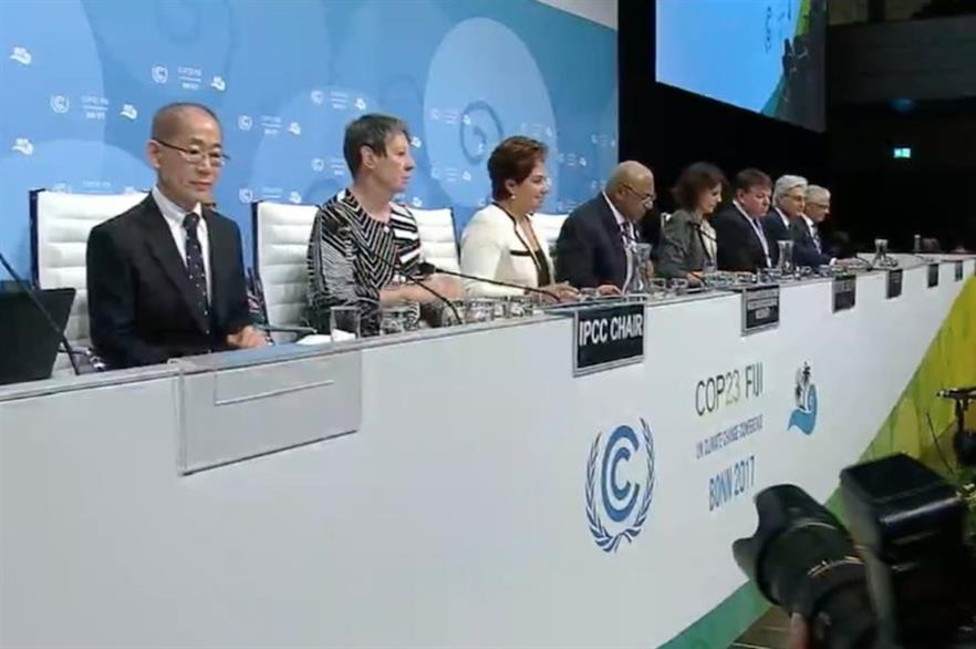 Fijian prime minister Frank Bainimarama (centre) takes his seat at the United Nations' Climate Change Conference in Bonn