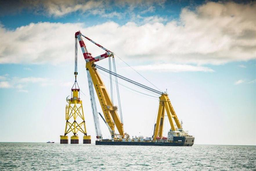 Boskalis' Asian Hercules III installing the suction-bucket foundation at Vattenfall's EOWDC project
