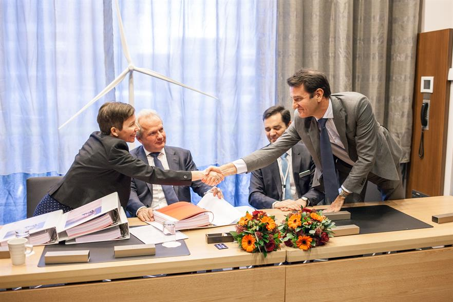 Vattenfall's Sandra Graues Nielsson shakes hands on the deal with Nordex's Patxi Landa in Amsterdam