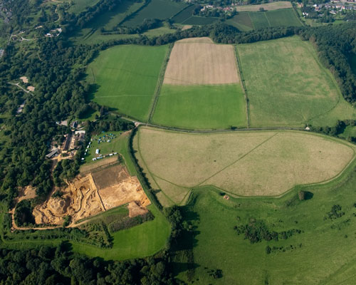 Ham Hill Hillfort, Somerset is the largest Iron Age hillfort in England. Ham Hill stone from the quarry on the lower left, part of the rectangular archaeological site, is important for the repair of historic buildings. Credit: English Heritage
