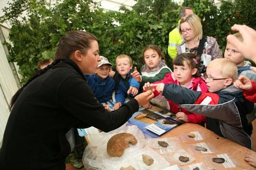 Education: children view archaeological relics (Image credit: Tarmac Ltd)