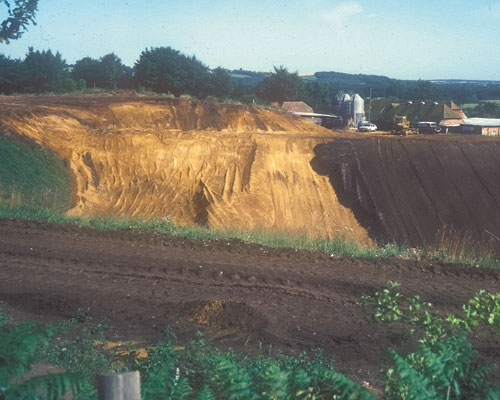 Topsoil materials are put in place as part of the restoration of a sand quarry in Hampshire. Credit: Andy Moffat