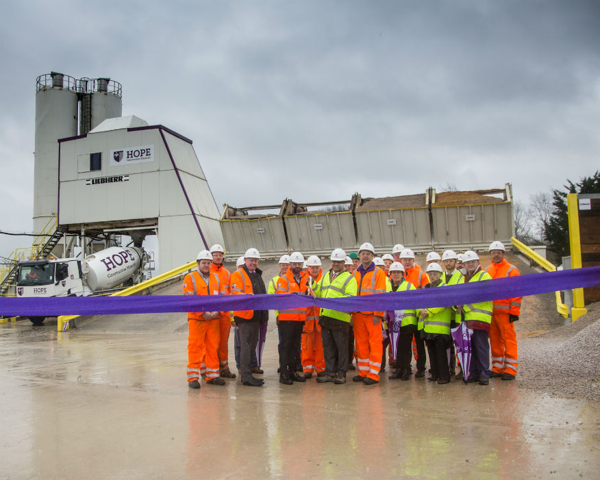 Local MP Alok Sharma (front row centre) cuts the ribbon to the new depot. Picture: Hope