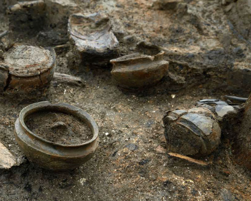 Household items including pots with charred remains of 3,000-year-old food. Picture: Cambridge Archaeological Unit/ Dave Webb