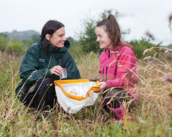 Ranger and local resident identify bugs on site. Photograph Land Trust