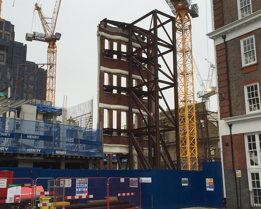 Construction in London has thrived, including building modern apartments behind old facades. Photograph: Matt Brown