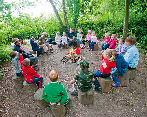 Natural spaces offer children the chance to play and learn about the environment and each other. Photograph  Helen Walsh/Wildlife Trusts