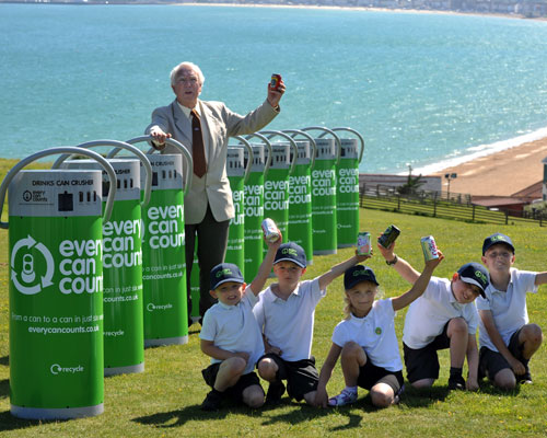 Can crushing machines will be introduced at Weymouth and Portland, Dorset. Ian Roebuck with pupils from Holy Trinity school (photo: Every Can Counts)