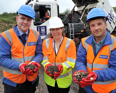 Oxfordshire County Council's Rebecca Harwood (middle) with sweepings. Picture: Grundon