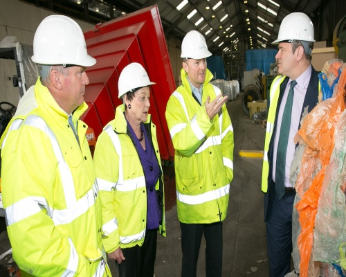Davey (right) sees waste become recycled pellet and new refuse sack. Picture PlasRecycle