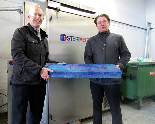 Aneurin Bevan University Health Board's Peter White (left) and Chris Davies with briquette. Photograph: Welsh government