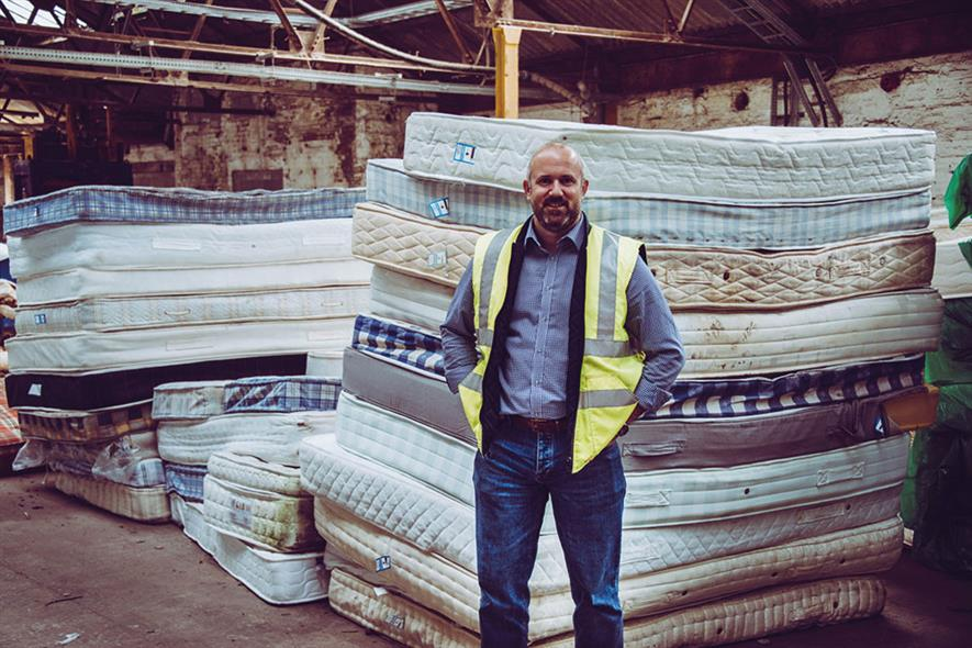 No time to rest: Nick Oettinger and some of the mattresses diverted from landfill. Photograph: Furniture Recycling Group
