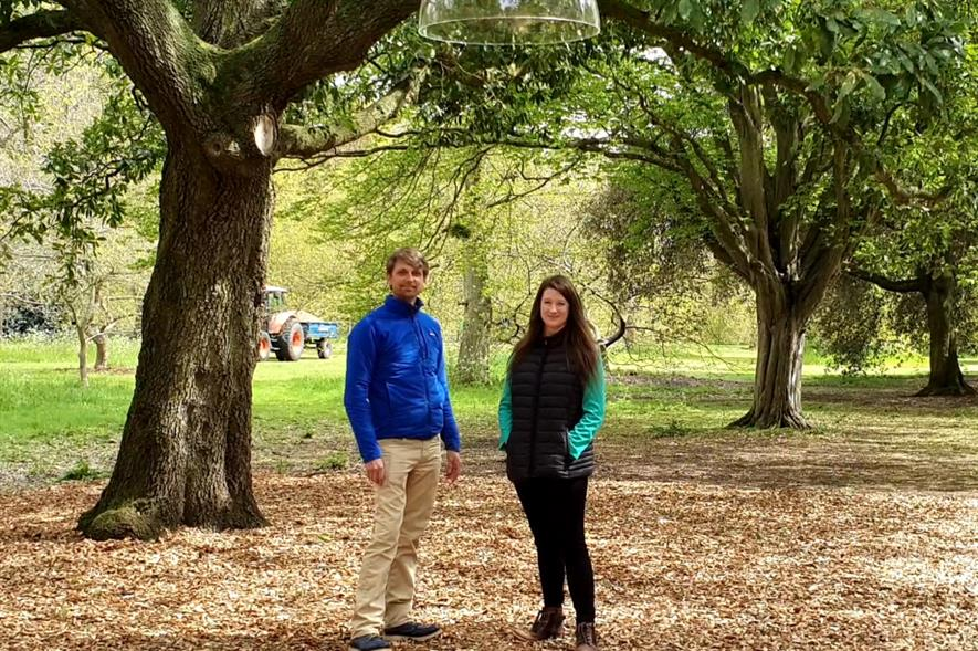 Artist Alex Metcalf and classical composer Carol J Jones beneath the tree sounds installation - credit: HW