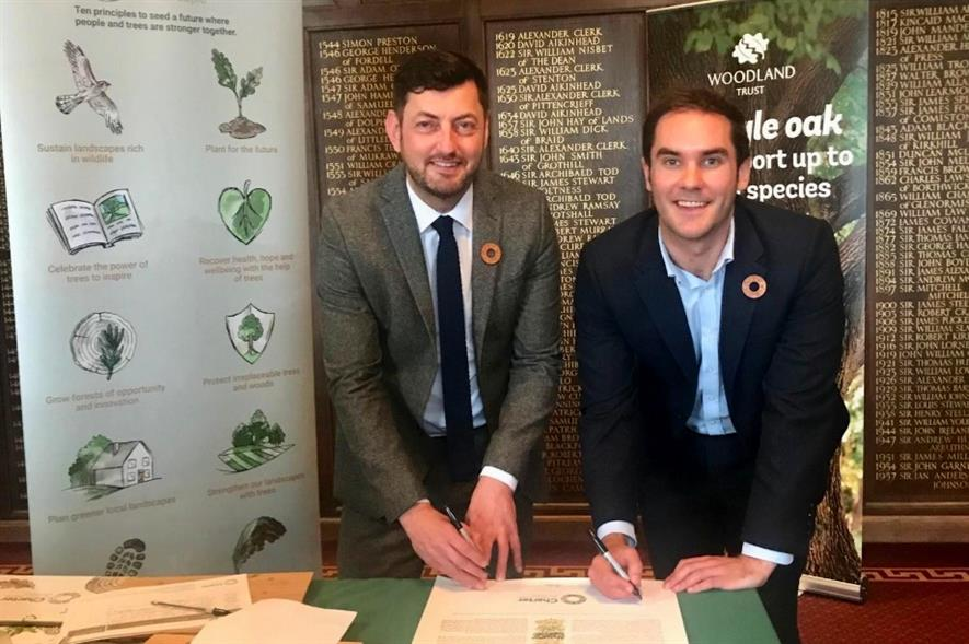 Councillors Cammy Day (left) and Adam McVey sign the Tree Charter - image: City of Edinburgh Council