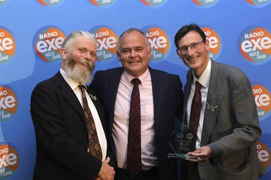 Jon Freeman (left) and Simon Bates (right) of Clyst Great Trees receive the award from Richard Marsh of sponsor Coastal Recycling - image: East Devon District Council