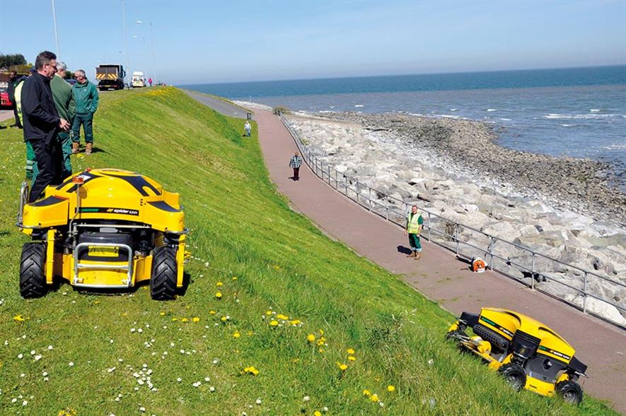 Conwy: two remote-control Spider mowers maintain steep banks along promenades - image: Dvorak