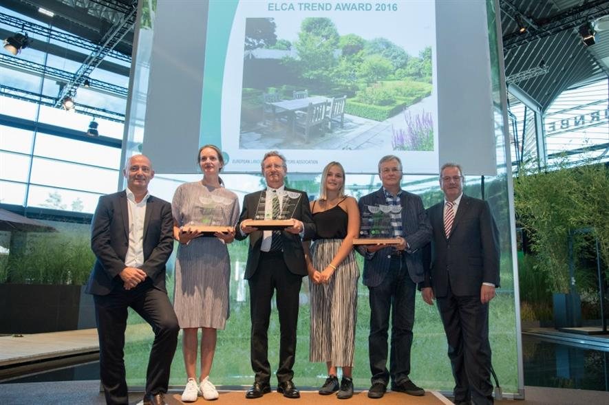 Linden Landscapes' owner Mick Callahan (centre left) collecting the winning award at GaLaBau 2016