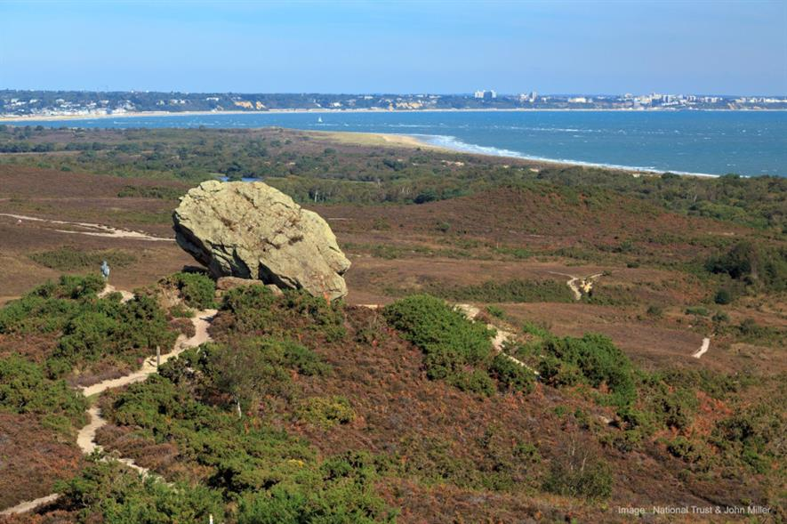 Godlingston Heath with Poole and Bournemouth in the distance - credit: National Trust Images and John Miller
