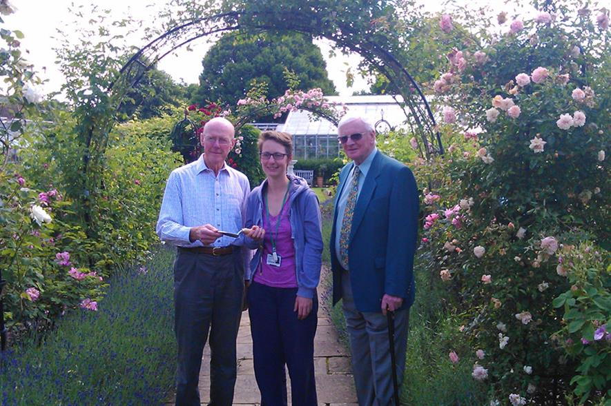 John Gibson presenting award to a past student winner at Capel Manor College with fellow Trustee Brian Crosby