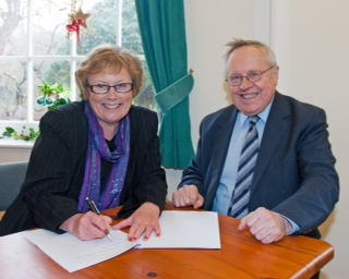 Myerscough College chief executive and principal for Myerscough College Ann Turner and HTNW chief executive John Miller sign the agreement