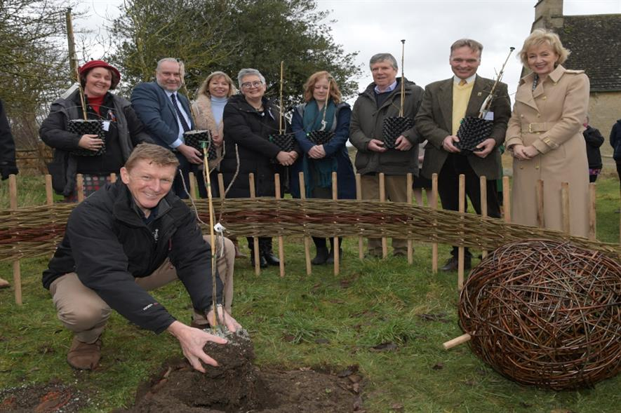 Astronaut Tim Peake plants a space sapling in the grounds of Woolsthorpe Manor - image: National Trust
