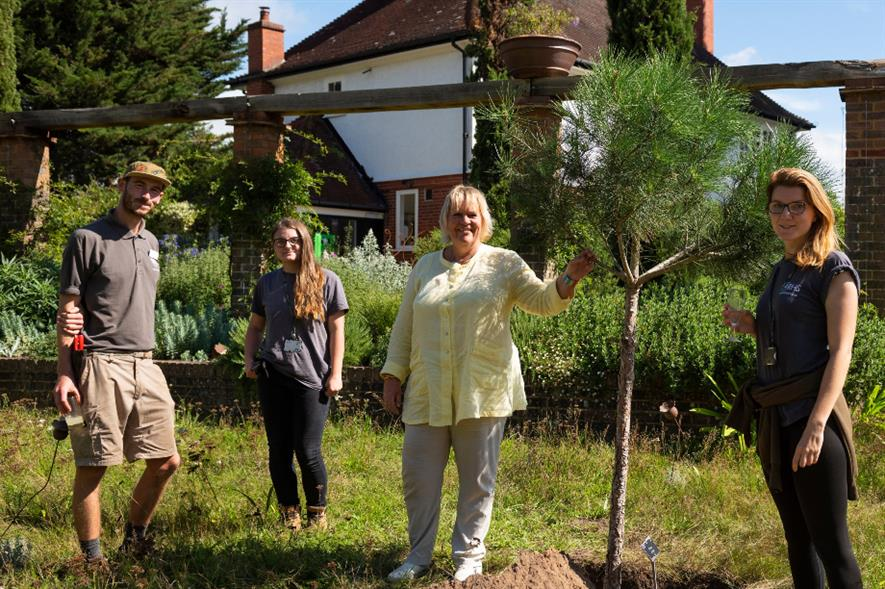Tree planting ceremony for director general Sue Biggs' (centre) 10th anniversary with the RHS - credit: RHS/Joanna Kossak