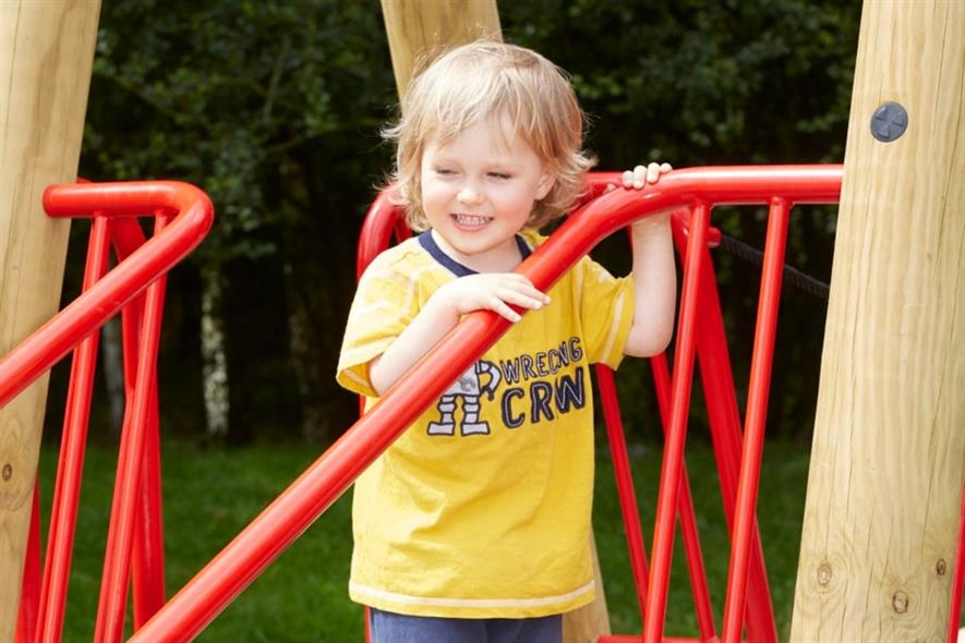 A child enjoys the new play area. Image: Sutcliffe Play