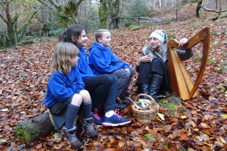 Pupils from Invergarry Primary School with singer and harpist Claire Hewitt - image: Trees for Life